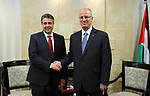 Palestinian Prime Minister Rami Hamdallah shakes hands with German Foreign Minister Sigmar Gabriel during a meeting in the West Bank city of Ramallah April 25, 2017. Photo by Prime Minister Office