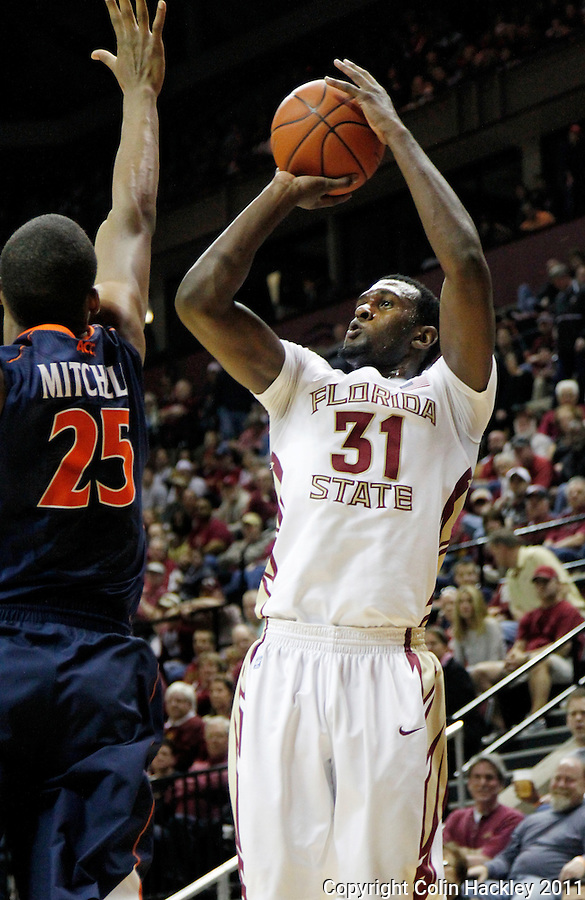 TALLAHASSEE, FL 10-FSU-VA MBB11 CH-Florida State's Chris Singleton puts in this third two point shot over Virginia's Akil Mitchell during first half action Saturday at the Donald L. Tucker Center in Tallahassee...COLIN HACKLEY PHOTO