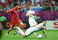 FUSSBALL  EUROPAMEISTERSCHAFT 2012   VORRUNDE Polen - Russland             12.06.2012 Yuri Zhirkov (li, Russland) gegen Marcin Wasilewski (re, Polen)