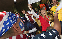 United States fan Andy Romhanyi  (left, back to camera) talks with England supporter Martina Gribbin inside the Royal Bafokeng Stadium before the start of the 2010 World Cup first round match between USA and England in Rustenberg, South Africa on Saturday, June 12, 2010.