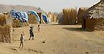 Children fly a kite in a camp for internally displaced families near Zalingei, in Sudan's war-torn Darfur region.