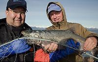 Bill Webber and Duke Moscrip with Freshly Caught Wild Coho Salmon on the Copper River Delta, Cordova, Alaska, US
