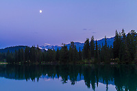 Gibbous Moon over Lac Beauvert, at Jasper Park Lodge, Jasper National Park, Alberta, Canada. Taken July 28, 2012 with Canon 7D and 16-35mm lens at ISO 100, f/10 and metered. Taken in twilight. Snow-covered peak is Mt. Edith Cavell.