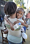 Rose Michel, a 10-year old survivor of the January 12 earthquake in Haiti, lost both her legs when the orphanage she was living in collapsed. Here she gets attention from Maura Senfre, a volunteer from the Dominican-Haitian Women's Movement (MUDHA).