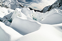 Downstream views over freshly snowed up crevasses on Franz Josef Glacier, Westland National Park, West Coast, New Zealand