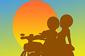 Couple riding a motorcycle into the sunset