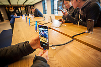 Visitors to the Samsung 837 showroom in the Meatpacking District in New York admire the Samsung Galaxy S8+ smartphone on Saturday, April 1, 2017. This is Samsung's first release after their reputation was tarnished by the exploding batteries in the Galaxy Note 7. (© Richard B. Levine)