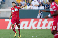 Chicago Fire midfielder Marco Pappa celebrates his goal pointing to his teammates Logan Pause & Patrick Nyarko. The Chicago Fire beat the LA Galaxy 3-2 at Home Depot Center stadium in Carson, California on Sunday August 1, 2010.