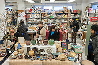 Holiday shoppers at a pottery studio in Chelsea in New York during the annual ceramics sale on Saturday, December 10, 2016 (© Richard B. Levine)