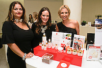 Staffe (left) Lauren Wolk (center) and Lisa Goldfaden (right) present Goldfaden beauty products at The Plaza Hotel, during Fashion's Night Out 2011.