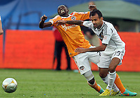 CARSON, CA - DECEMBER 01, 2012:   Juninho (19) of the Los Angeles Galaxy pushes off on Boniek Garcia (27) of the Houston Dynamo during the 2012 MLS Cup at the Home Depot Center, in Carson, California on December 01, 2012. The Galaxy won 3-1.