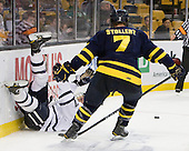 Paul Thompson (UNH - 17), Karl Stollery (Merrimack - 7) - The Merrimack College Warriors defeated the University of New Hampshire Wildcats 4-1 (EN) in their Hockey East Semi-Final on Friday, March 18, 2011, at TD Garden in Boston, Massachusetts.