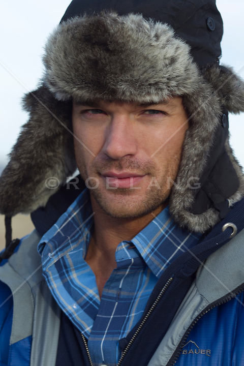 good looking man wearing a fur hat