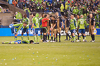 Alejandro Moreno (15) pleads with the referee after teammate Toni Stahl (12) was ejected following a serious hit on Fredy Montero (l - on ground) as the Seattle Sounders defeated the Philadelphia Union, 2-0, in an MLS match on Thursday, March 25, 2010 at Qwest Field in Seattle, WA. It was the Sounders home opener and the first regular season game for the expansion Philadelphia Union.