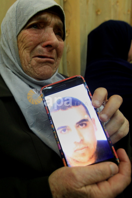 Aisha Eskafi Grandmother of Palestinian Omar Eskafi,21, who was shot dead after he allegedly injured two Israelis in a stabbing attack in central Jerusalem on Saturday night mourns in their house in Jerusalem on Dec. 07, 2015. At least 112 Palestinians have been killed by Israelis since the beginning of October. While Israel alleges many of those were attempting to attack Israelis when they were shot, Palestinians and rights groups have disputed Israel's version of events in a number of cases. Photo by Mahfouz Abu Turk