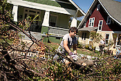 April 17, 2011. Raleigh, NC.. Scott Shackelton helps neighbors remove fallen trees from their yard..  A record 92 tornadoes tore through North Carolina on April 16, 2011, killing at least 22 people and injuring more than 80 others. Damage to the city of Raleigh was extensive, with much of it concentrated in the Oakwood neighborhood on the edge of downtown..