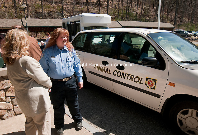 CANAAN,  CT,  CT-041315JS01- Winsted Mayor Candace Bouchard and Animal Control Officer Alicia Campbell look over the new animal control vehicle Monday during a visit to the Geer campus in Canaan on Monday. They were there to thank the anonymous donor who gave $5000 to purchase and outfit the vehicle. <br /> Jim Shannon Republican-American