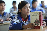 Uyghur students study Uyghur language in Hetian Experimental Billingual School, in Hetian, Xinjiang province, China, on October 13, 2006. The Uyghur people are a Turkic ethnic group living mainly in the Xinjiang Uyghur Autonomous Region of China. Photo by Lucas Schifres/Pictobank