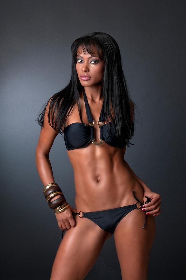 Sensual latin girl wearing a sexy vikini.
