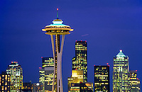 Twilight view of the skyline with the Space Needle and skyscrapers in Seattle Washington.