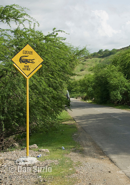 Crocodile crossing sign on the road from Dili to Baucau, Timor-Leste (East Timor). Saltwater crocodiles, Crocodylus porosus, are common in this area.