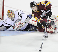San Antonio Rampage goaltender Jacob Markstrom, left, looks on as Chicago Wolves' Jordan Schroeder loses control of the puck during the first period of an AHL playoff hockey game, Saturday, April 21, 2012, in San Antonio. (Darren Abate/pressphotointl.com)