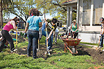 College teens work on water system in yard of home outdoors in New Orleans, Louisiana to rebuild the city