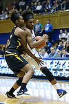 05 November 2015: Duke's Crystal Primm (right) and Pfeiffer's Ariana Tillman (left). The Duke University Blue Devils hosted the Pfeiffer University Falcons at Cameron Indoor Stadium in Durham, North Carolina in a 2015-16 NCAA Women's Basketball Exhibition game. Duke won the game 113-36.