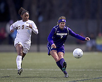 "University of Washington midfielder Kellye Joswick (7) passes the ball as Boston College forward Natalie Crutchfield (9) closes. In overtime, Boston College defeated University of Washington, 1-0, in NCAA tournament ""Elite 8"" match at Newton Soccer Field, Newton, MA, on November 27, 2010."