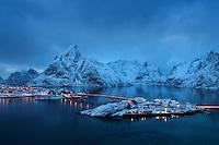 Winter twilight view over rorbu cabins of Sakrisøy, Reine, Moskenesøy, Lofoten Islands, Norway