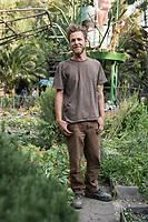 Joshua Nichols, a volunteer at the Urban community garden project Roma Verde, Colonia Roma, Mexico City, Mexico