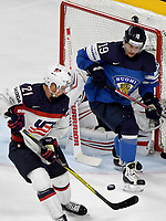 American Dylan Larkin (L) attempts to score past Finland's Veli-Matti Savinainen during the Ice Hockey World Championship quarter-final match between the US and Finland in the Lanxess Arena in Cologne, Germany, 18 May 2017. Photo: Monika Skolimowska/dpa /MediaPunch ***FOR USA ONLY***