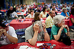 Undecided Republican voter Bill Robison listens to presidential candidates speak at a Republican dinner in Tiffin, Iowa, August 5, 2011.