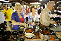 NWA Democrat-Gazette/DAVID GOTTSCHALK - 5/19/15 - Bea Guthrie (left to right), Joanna Hudson and Pete Loris, guests and members of the Rural Builders Club, an all-female group, make their way through the lunch line featuring soup served in the basement of Son's Chapel in Fayetteville Tuesday May 19, 2015. A 75th anniversary of the dedication of the chapel with an open house is planned for May 30.