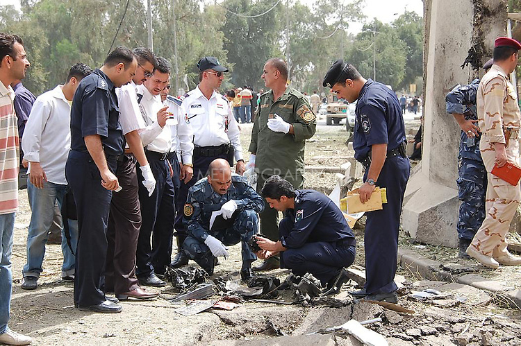 BAGHDAD, IRAQ:  Iraqi Police inspect the destruction outside the Iranian Embassy after car bombs go off in Baghdad...Three car bombs hit the centre of the Iraqi capital, Baghdad, in quick succession, killing at least 30 people and injuring about 160 people.  The bombs appeared to target the Iranian embassy, and the Egyptian, Syrian and German missions in Iraq.