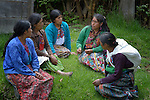 Mayan women in a discussion at an eco-agricultural training center in Comitancillo, Guatemala. The center is sponsored by the Maya Mam Association for Investigation and Development (AMMID).