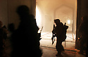 U.S. Army 3rd Division 3-7 infantry platoon sweeps through the VIP terminal of Baghdad International Airport during a dawn advance on the Iraqi capital April 4, 2003 in Baghdad.
