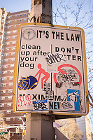 "A heavily vandalized sign admonishing pet owners to pick up after their dogs do their business is seen in the Chelsea neighborhood of New York on Thursday, November 28, 2013. The NYC Dept. of Transportation  is removing the signs in an effort to reduce visual clutter on the street. The signs are consider redundant as pet owners already know about the ""pooper scooper"" law, enacted in 1978. The signs have not been maintained in ten years and the fine is now $250.(© Richard B. Levine)"