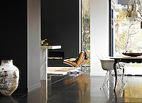 A tiled floor of black basalt unifies the open plan living/dining area