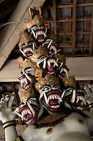 Ogoh Ogoh (demon) sculpture of Butha Sia (Sembilan kepala - nine heads), left side (evil side) of classic balinese wayang kulit pantheon, West Ubud, Penestanan, Central Bali. Balinese New Year called Nyepi (around march according to lunar calendar),  is a silent day of meditation and spiritual purification. One day before exorcist rituals are held for purification and balance of polar powers of the universe, first at noon by a priest (exorcism called Caru or Tawur Agung) and later on after sunset in a popular, carneval-like procession of Ogoh-Ogoh, symbolizing bhuta kali (demon, bad spirits,bad habits),  so all the bad spirits leave the village and the island.  Loud, rhythmic music and special performances are part of the procession called Ngerupuk. Road crossings are major spots of exorcism and special ogoh-ogoh performance, since demons often like to dwell here. At Nyepi, the following day, there is 24 hours silence, no vehicle or people on the street, no light or fire, no working  all the bad spirits should think, the island is abandoned and leave the island. Day after Nyepi is a day of reconciliation  new year starts purified.