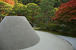 "Ginkakuji is a Zen temple at the foot of Kyoto's Higashiyama or ""eastern mountain"". The temple was formally known as Tozan Jishoji and built in 1482 as a retirement villa for shogun Ashikaga Yoshimasa. A few years later, the Silver Pavilion was constructed, modeled after Kinkakuji's Golden Pavilion. Plans to cover the pavilion in silver were never realized yet the name Silver Pavilion stuck. The villa was converted into a Zen temple after Yoshimasa's death and is well known for its zen garden."