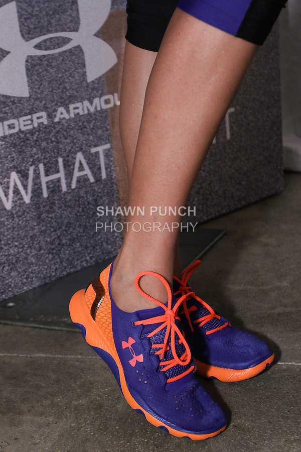 "Model poses in sneakers during the Under Armour, ""I will what I want"" global women's campaign launch, on July 31, 2014, in New York City."