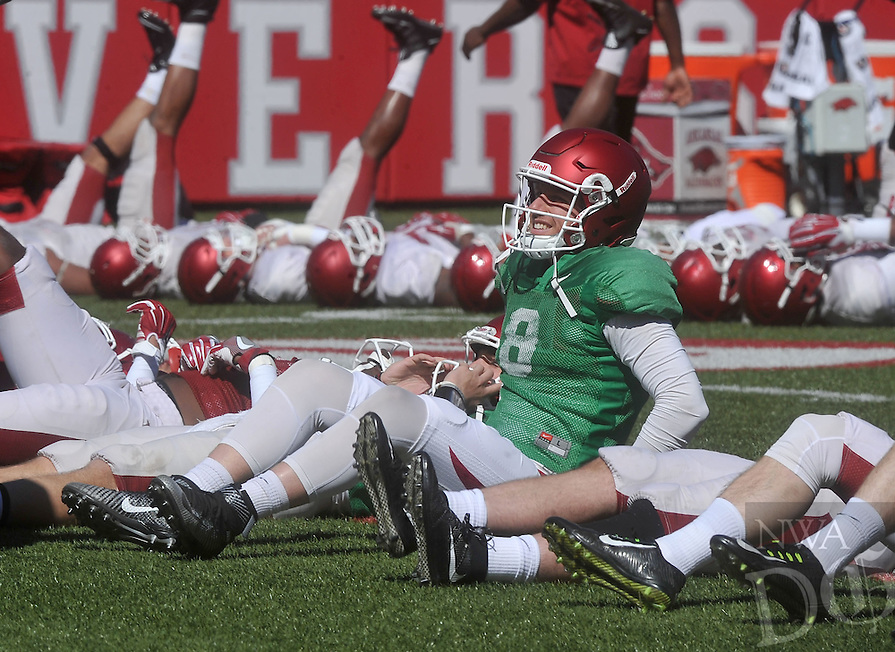 NWA Democrat-Gazette/MICHAEL WOODS &bull; @NWAMICHAELW<br /> University of Arkansas quarterback Austin Allen (8) stretches out during practice Saturday April 2, 2016, at Razorback Stadium.