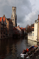 """BRUGES, BELGIUM - FEBRUARY 08 : A general view of the """"Befroi"""" (Belfort) from Rozenhoedkaai on February 08, 2009 in Bruges, West Flanders, Belgium. The belfry is 83m tall, was built in 1240 and is listed by the UNESCO as World Heritage Site. A wooden small embarcation with tourists on board, is waiting for the next city guide departure. (Photo by Manuel Cohen)"""