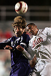 11 November 2005: Duke's Chris Loftus (left) challenges Maryland's A.J. Godbolt (right) for a header. Duke University defeated the University of Maryland 4-2 at SAS Stadium in Cary, North Carolina in a semifinal of the 2005 ACC Men's Soccer Championship.