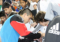 Andrew Quinn #48 of D.C. United signs autographs during an MLS match against the New England Revolution on April 3 2010, at RFK Stadium in Washington D.C.