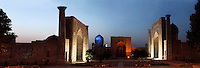 Panoramic view of the Registan Square, Samarkand, Uzbekistan, pictured on July 16, 2010 at twilight. Floodlighting picks out the elaborately tiled arches and the jewel like blue dome of the fabulous buildings in the complex.  Samarkand, a city on the Silk Road, founded as Afrosiab in the 7th century BC, is a meeting point for the world's cultures. Its most important development was in the Timurid period, 14th to 15th centuries.