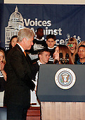 United States President Bill Clinton is introduced at &quot;Voices against Violence: A Congressional Teen Conference&quot; in Washington, DC by Rebecca Hunter, 17, a senior at Hillsboro Comprehensive High School in Nashville, Tennessee on October 19, 1999.  Rebecca conceived of and launched a school-wide initiative urging her fellow students to pledge to become part of the solution to the problem of youth violence.  By the end of the first week, 1,000 students at Hillsboro had signed up, and by the end of the next week 40 other schools had joined her initiative.  To date, over 500 schools nationwide have adopted Rebecca's pledge.<br /> Credit: Ron Sachs / CNP
