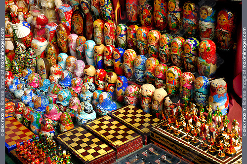 Colorful set of decorative nesting dolls matreshkas standing in rows and chess boards. Ukrainian souvenirs, arts and crafts