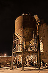 A concrete plant in Wakefield, MA is ominous at night.